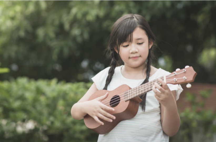Girl Playing Yukulele